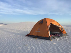 orange tent, white sand, epic location